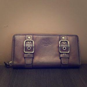 Coach accordion zip wallet in bronze, with pink